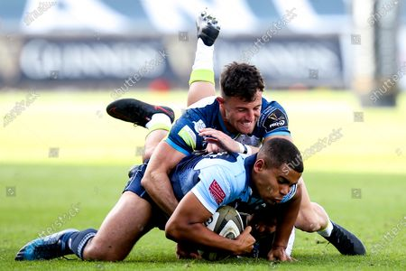 Cardiff Blues vs Ospreys. Blues' Ben Thomas is tackled