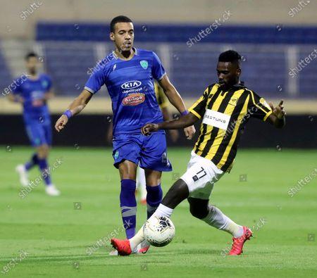 Al-Fateh's player Sofiane Bendebka (L) in action against Al-Ittihad's Abdulaziz Al-Bishi (R) during the Saudi Professional League soccer match between Al-Fateh and Al-Ittihad, in Al-Hasa, Saudi Arabia, 30 August 2020.