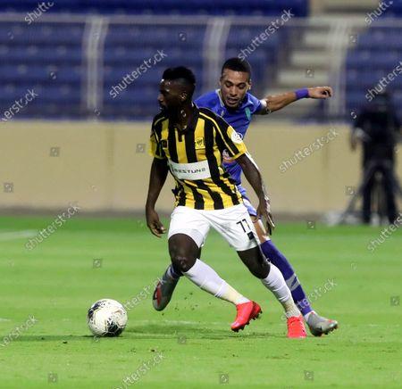 Al-Fateh's player Sofiane Bendebka (back) in action against Al-Ittihad's Abdulaziz Al-Bishi (front) during the Saudi Professional League soccer match between Al-Fateh and Al-Ittihad, in Al-Hasa, Saudi Arabia, 30 August 2020.