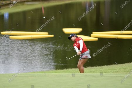 Jenny Shin chips onto the 14th green during the final round of the LPGA Walmart NW Arkansas Championship golf tournament, in Rogers, Ark