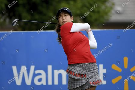 Jenny Shin, of South Korea, watches her tee shot on the first hole during the final round of the LPGA Walmart NW Arkansas Championship golf tournament, in Rogers, Ark
