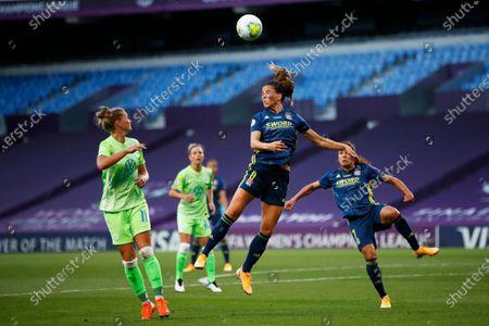 Lyon's Sara Bjork Gunnarsdottir, center, heads the ball during the Women's Champions League final soccer match between Wolfsburg and Lyon at the Anoeta stadium in San Sebastian, Spain