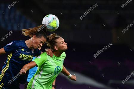 Lyon's Sara Bjork Gunnarsdottir, left, jumps for the ball with Wolfsburg's Alexandra Popp during the Women's Champions League final soccer match between Wolfsburg and Lyon at the Anoeta stadium in San Sebastian, Spain