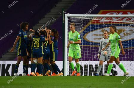 Lyon's Sara Bjork Gunnarsdottir celebrates with teammates, left, after scoring her side's third goal during the Women's Champions League final soccer match between Wolfsburg and Lyon at the Anoeta stadium in San Sebastian, Spain