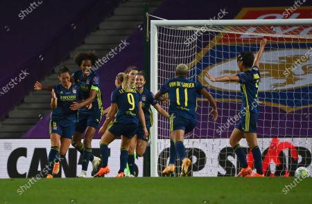 Lyon's Sara Bjork Gunnarsdottir, left, celebrates with teammates after scoring her side's third goal during the Women's Champions League final soccer match between Wolfsburg and Lyon at the Anoeta stadium in San Sebastian, Spain