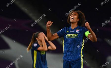 Lyon's Wendie Renard, right, and Lyon's Sara Bjork Gunnarsdottir celebrate at the end of the Women's Champions League final soccer match between Wolfsburg and Lyon at the Anoeta stadium in San Sebastian, Spain, . Lyon won the match 1-3
