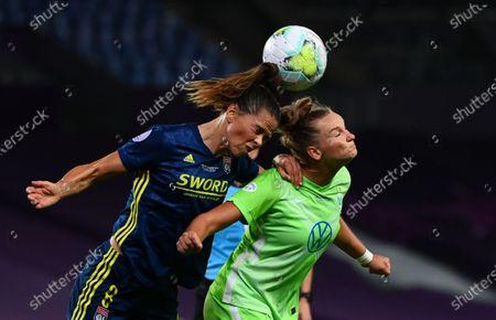 Alexandra Popp (R) of Wolfsburg in action against Sara Bjork Gunnarsdottir of Lyon during the UEFA Women Champions League final between Vfl Wolfsburg and Olympique Lyon in San Sebastian, Spain, 30 August 2020.
