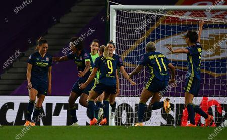 Sara Bjork Gunnarsdottir (L) of Lyon celebrates after scoring the 3-1 lead with teammates during the UEFA Women Champions League final between Vfl Wolfsburg and Olympique Lyon in San Sebastian, Spain, 30 August 2020.