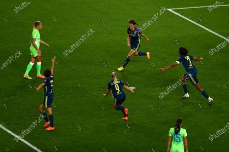 Lyon's Sara Bjork Gunnarsdottir (C up) celebrates after scoring the 3-1 lead during the UEFA Women Champions League final between Vfl Wolfsburg and Olympique Lyon in San Sebastian, Spain, 30 August 2020.