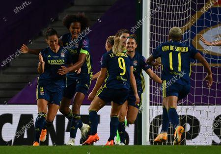 Sara Bjork Gunnarsdottir (L) of Lyon celebrates after scoring the 3-1 leadi with teammates during the UEFA Women Champions League final between Vfl Wolfsburg and Olympique Lyon in San Sebastian, Spain, 30 August 2020.