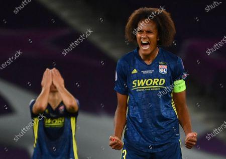 Wendie Renard (R), and Sara Bjork Gunnarsdottir of Lyon celebrate after wining the UEFA Women Champions League final between Vfl Wolfsburg and Olympique Lyon in San Sebastian, Spain, 30 August 2020.