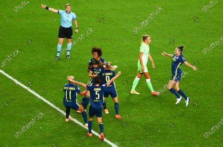 Lyon's Sara Bjork Gunnarsdottir is congratulated by teammates after scoring her team's third goal during the Women's Champions League final soccer match between Lyon and Wolfsburg at Anoeta Stadium, in San Sebastian, Spain