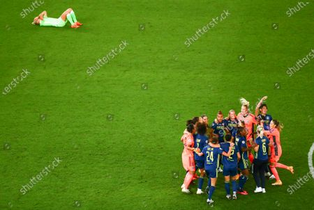 Lyon players, right, celebrate after defeating Wolfsburg in the Women's Champions League final soccer final at Anoeta Stadium, in San Sebastian, Spain
