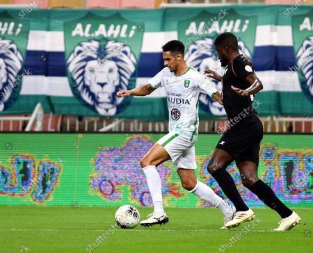 Stock Image of Al-Ahli's player Ali Al-Asmari (L) in action against Al-Shabab's Alfred N'Diaye (R) during the Saudi Professional League soccer match between Al-Ahli and Al-Shabab, 30 kilometers north of Jeddah, Saudi Arabia, 30 August 2020.