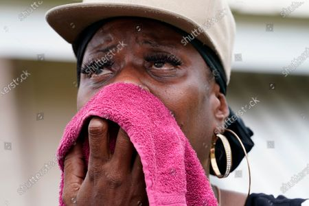Rakisha Murray cries in relief as she arrives to see her mother's home undamaged, after she returned from evacuation with her mother and other family in Lake Charles, La., in the aftermath of Hurricane Laura