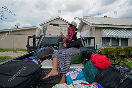 Rakisha Murray cries in relief as she arrives to see her mother's home largely undamaged, after she returned from evacuation with her mother and other family in Lake Charles, La., in the aftermath of Hurricane Laura