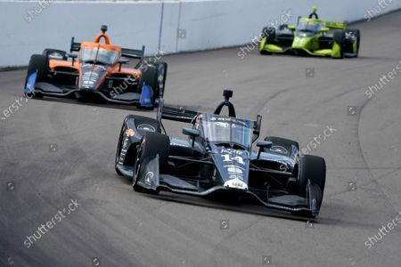 Tony Kanaan (14) drives into Turn 1 followed by Oliver Askew (7) and Charlie Kimball (4) during the IndyCar auto race at World Wide Technology Raceway, in Madison, Ill