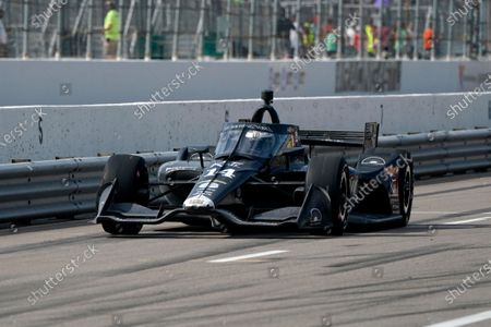 Tony Kanaan heads out of the pits during the IndyCar auto race at World Wide Technology Raceway, in Madison, Ill