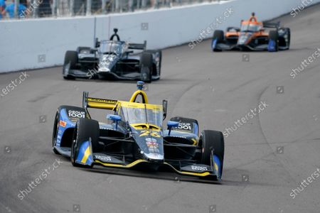 Zach Veach (26) drives into Turn 1 followed by Tony Kanaan (14) during the IndyCar auto race at World Wide Technology Raceway, in Madison, Ill