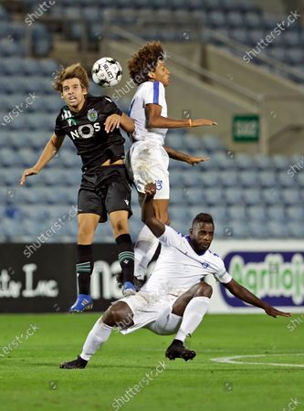 Stock Photo of Sporting player Daniel Braganca (L) fights for the ball with Robinho (C) and Silvestre Varela of Belenenses SAD during their preparation soccer match held at Algarve Stadium, Faro, Portugal, 30 August 2020.