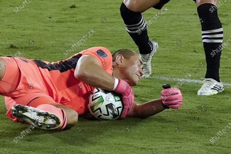 Inter Miami goalkeeper Luis Robles blocks a shot by Nashville SC during the first half of an MLS soccer match, in Nashville, Tenn
