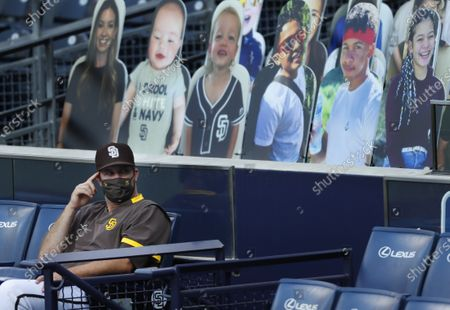 San Diego Padres pitcher Drew Pomeranz looks on during a game against the Seattle Mariners with cut outs filling the stands at Petco Park