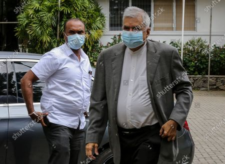 Stock Photo of Former Sri Lankan Prime Minister Ranil Wickremesinghe (R) arrives to record a statement regarding the the 2019 Easter Sunday terrorist bombing, at the Investigation Unit of the Presidential Commission of Inquiry in Colombo, Sri Lanka, 31 August 2020. A series of bomb attacks were carried out on Easter Sunday, 21 April 2019, in Sri Lanka, killing nearly 300 people and injuring hundreds of others. Later investigations revealed the involvement of an Islamic terror group claiming to be affiliated to the ISIS.