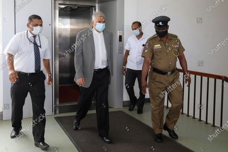 Former Sri Lankan Prime Minister Ranil Wickremesinghe (2-L) arrives to record a statement regarding the the 2019 Easter Sunday terrorist bombing, at the Investigation Unit of the Presidential Commission of Inquiry in Colombo, Sri Lanka, 31 August 2020. A series of bomb attacks were carried out on Easter Sunday, 21 April 2019, in Sri Lanka, killing nearly 300 people and injuring hundreds of others. Later investigations revealed the involvement of an Islamic terror group claiming to be affiliated to the ISIS.