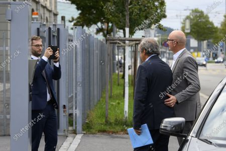 Lawyer Dominic Nellen (L) takes a picture of former UEFA president Michel Platini (C) and a motorist (R) in front of the building of the Office of the Attorney General of Switzerland, in Bern, Switzerland, 31 August 2020. Former UEFA president Michel Platini and former FIFA president Sepp Blatter each face interrogation from the Swiss public prosecutor as part of the proceedings opened in 2015 over a payment of 2 million Swiss francs. Platini's hearing is on 30 August, Blatter's hearing on 01 September.