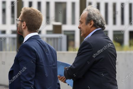 Former UEFA president Michel Platini (R) walks in front of the building of the Office of the Attorney General of Switzerland, in Bern, Switzerland, 31 August 2020. Former UEFA president Michel Platini and former FIFA president Sepp Blatter each face interrogation from the Swiss public prosecutor as part of the proceedings opened in 2015 over a payment of 2 million Swiss francs. Platini's hearing is on 30 August, Blatter's hearing on 01 September.