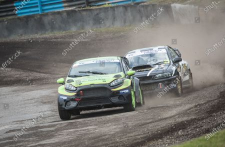 Mike Manning, leads Dominic Flitney, out of Chessons during the 5 Nations British Rallycross at Lydden Hill Race Circuit on 31st August 2020