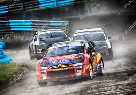 Tristan Ovenden,  leads  Sir Chris Hoy MBE,  and Mark Donnelly, out of Chessons during the 5 Nations British Rallycross at Lydden Hill Race Circuit on 31st August 2020