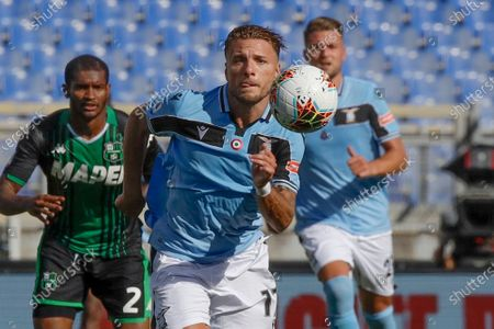 """Stock Photo of Lazio's Ciro Immobile eyes the ball during the Serie A soccer match between Lazio and Sassuolo at the Rome Olympic Stadium. Prolific scorer Ciro Immobile has extended his contract with Lazio through 2025. His previous contract was due to expire in 2023.""""This is important, because Immobile had gained the attention of some big clubs, considering that he's the European Golden Shoe holder,"""" Lazio communications director Stefano De Martino said Monday"""
