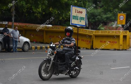 "Stock Photo of Anand Pal, supporter of lawyer Prashant Bhushan, seen riding his motorbike with a placard ""I Love Prashant Bhushan"" at Jantar Mantar road, on August 30, 2020 in New Delhi, India."