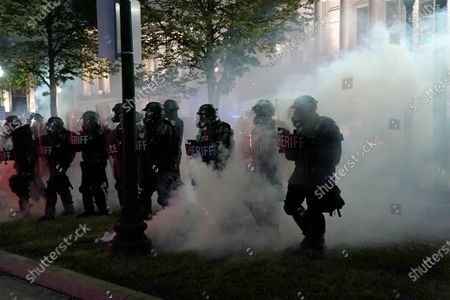 Police clear a park during clashes with protesters outside the Kenosha County Courthouse in Kenosha, Wis., during demonstrations over the Sunday shooting of Jacob Blake. Unrest over the past week in a critical battleground state could sway the course of the election