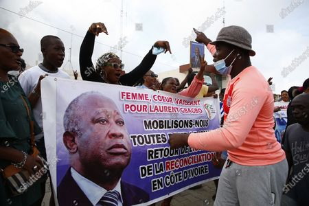 Supporters of former President Laurent Gbagbo, barred from participating in the October presidential election, react as they gather to defy the ruling by waiting for the arrival of the representative of their candidate to submit application for October election at the Independent Electoral Commission office in Abidjan, Ivory Coast, 31 August 2020. The supporters have said they will file his candidacy in his name for the country's presidential elections scheduled for 31 October 2020. Candidates have until midnight on 31 August to submit their bids for the presidential race. Gbagbo remains in Belgium where he awaits a passport to return home after being cleared of crimes against humanity by the International Criminal Court at the Hague in 2019.