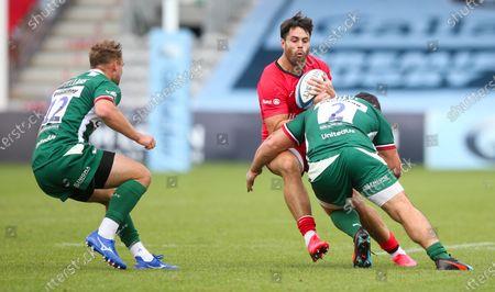 Sean Maitland of Saracens tackled by Agustin Creevy of London Irish - Matt Williams of London Irish (L)