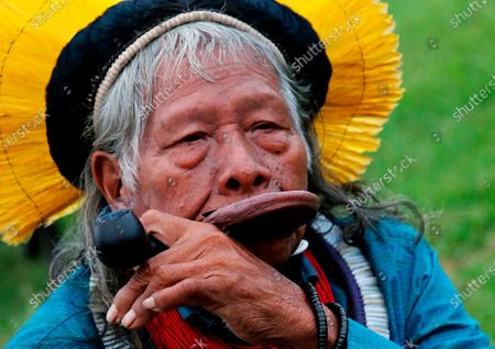 Kayapo tribal leader Raoni Metuktire smokes a pipe after a press conference in Bidart, southwestern France. The Indigenous leader emblematic of the fight for the preservation of the Amazon forest in Brazil was hospitalized with symptoms of pneumonia and tested positive for COVID-19, according to the Raoni Institute on