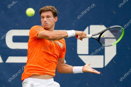 Pablo Carreno Busta, of Spain, returns a shot to Yasutaka Uchiyama, of Japan, during the first round of the US Open tennis championships, in New York