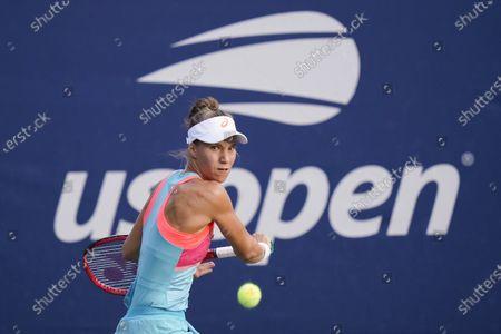 Viktorija Golubic, of Switzerland, returns a shot to Vera Lapko, of Belarus, during the first round of the US Open tennis championships, in New York