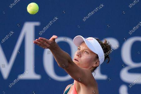 Stock Image of Viktorija Golubic, of Switzerland, serves to Vera Lapko, of Belarus, during the first round of the US Open tennis championships, in New York