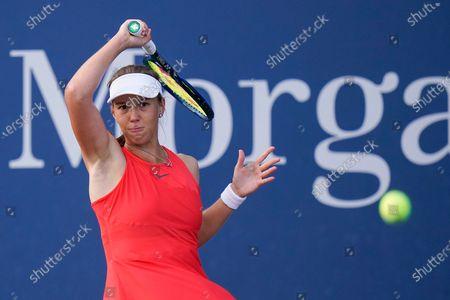 Vera Lapko, of Belarus, returns a shot to Viktorija Golubic, of Switzerland, during the first round of the US Open tennis championships, in New York
