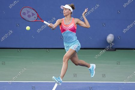 Stock Picture of Viktorija Golubic, of Switzerland, returns a shot to Vera Lapko, of Belarus, during the first round of the US Open tennis championships, in New York