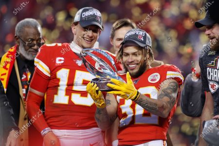 """Kansas City Chiefs' Tyrann Mathieu and Patrick Mahomes (15) hold up the Lamar Hunt Trophy after the NFL's AFC Championship football game against the Tennessee Titans, in Kansas City, Mo. When star quarterback Patrick Mahomes, fast becoming the face of the league, speaks out in support of the Black Lives Matter movement, the Chiefs in turn support him. When safety Tyrann Mathieu and defensive end Frank Clark discuss the importance of registering people to vote, Chiefs chairman Clark Hunt and his top lieutenants respond: """"How can we help"""