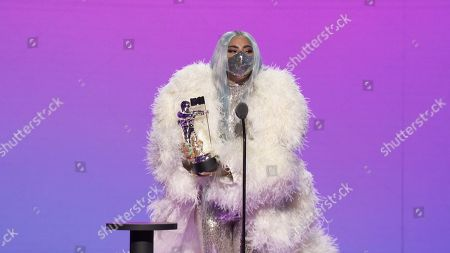 Lady Gaga accepts the Artist of the Year award
