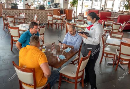 Costumers order food inside the Las Vegas Cuisine Restaurant in Doral, Florida, USA, 31 August 2020. Miami-Dade Mayor Carlos Gimenez allowed casinos to reopen on 31 August after an eight-week closure, lifting restrictions on the entertainment hubs on the same day he lets restaurants resume indoor dining.