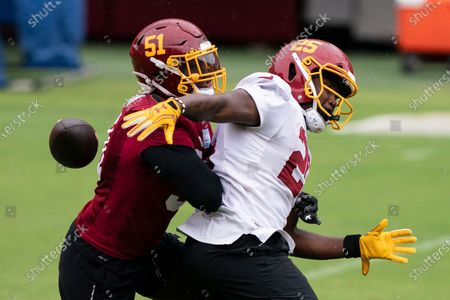 Washington linebacker Shaun Dion Hamilton (51) breaks up a pass to Washington running back Peyton Barber (25) during an NFL football practice at FedEx Field, in Washington