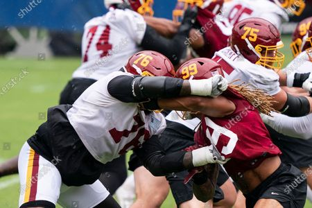 Washington offensive tackle Morgan Moses (76) blocks defensive end Chase Young (99) during an NFL football practice at FedEx Field, in Washington