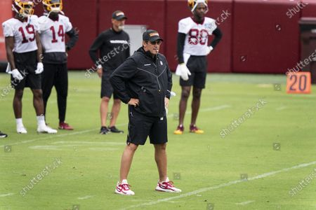 Washington head coach Ron Rivera watches his team during an NFL football practice at FedEx Field, in Washington