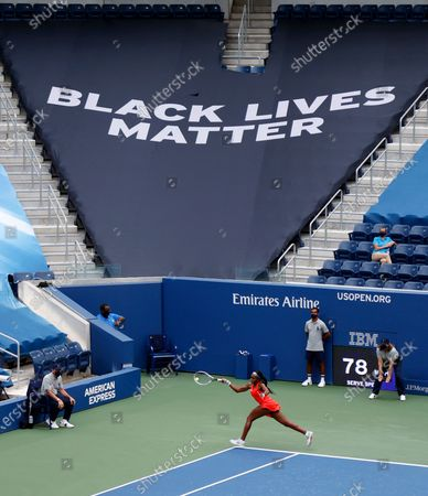 A Black Lives Matter banner is seen above Cori 'Coco' Gauff of the US (Bottom-Center) as she hits a return to Anastasija Sevastova of Latvia during their match on the first day of the US Open Tennis Championships the USTA National Tennis Center in Flushing Meadows, New York, USA, 31 August 2020. Due to the coronavirus pandemic, the US Open is being played without fans and runs from 31 August through 13 September.